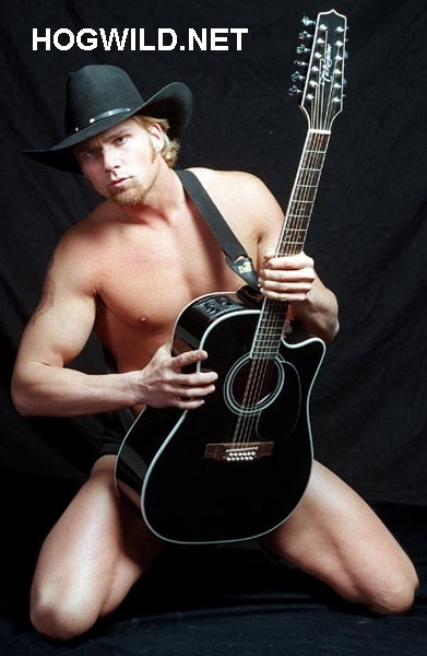 Naked Cowboy's got a big guitar